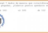 María Elena pegó 7 dados de manera que coincidieran los números de las caras pegadas....